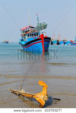 anchor Fishing Boats in the bay in Vietnam Phan Thiet fishing harbor