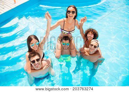 Funky, Sunny, Romance, Carefree, Chilling Mood. High Angle Shot Of Three Happy Boyfriends Piggybacki
