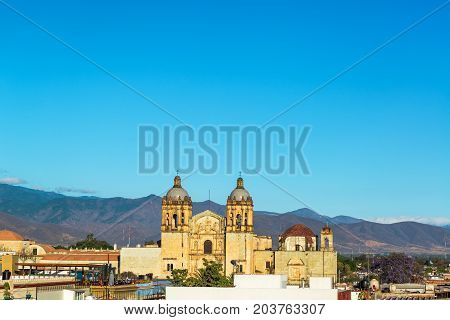 Santo Domingo church in Oaxaca Mexico with hills rising in the background