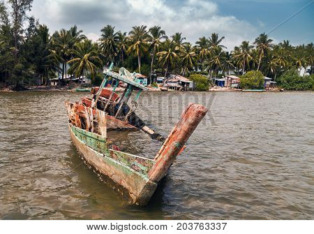 Old wrecked ship on the beach sea coast. Floods Natural Disaster jungle island sea landscape with palm trees