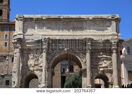 ROME, ITALY - JULY 17, 2017: Triumphal Marble Arch of Septimius Severus on the Capitoline Hill, Roman Forum, Rome, Italy