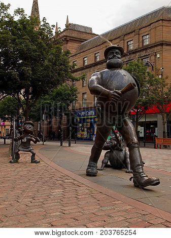 Desperate Dan from Dundee. Dundee, Scotland - July 30, 2017 Monument to the characters of British comics Dan and Beano Minnie in the center of the Scottish city of Dundee.