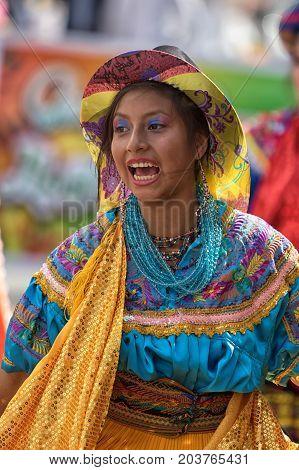 June 17 2017 Pujili Ecuador: closeup of a female dancer with colorful traditional clothing at the Corpus Christi annual parade
