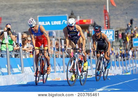 STOCKHOLM - AUG 26 2017: Climbing group of female triathlete cyclists Routier Beaugrand and Kuramoto in the Women's ITU World Triathlon series event August 26 2017 in Stockholm Sweden