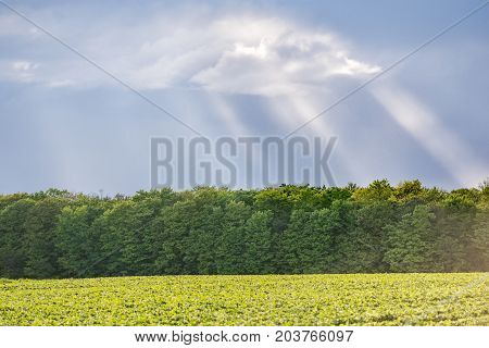 Landscape View Of Ile D'orleans, Quebec, Canada During Sunset With Sun Rays, Clouds Farm Field And F