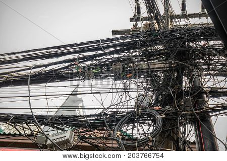 Electic cables mess at the streets of Phuket, Thailand.