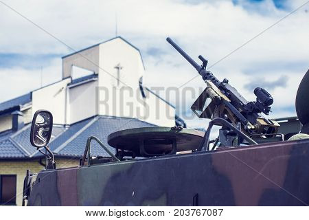 m2 browning machine gun on M113 armored personnel carrier Near a church