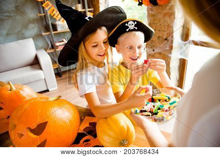 Wow! Sweets For Us! Very Cheerful Excited Kids In Carnival Head Wear, With Treats, Rear Cropped View