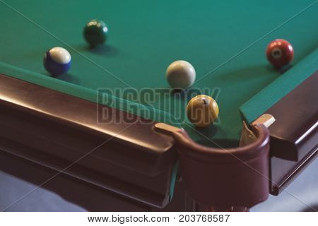 Billiard Balls in a pool table during game. Number one on front