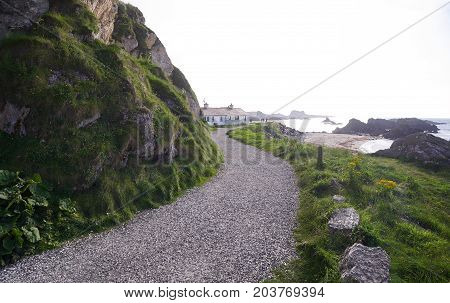 Path leading to houses in Ballintoy Harbour, Antrim, Northern Ireland