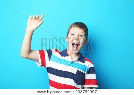 Portrait Of Young Boy On Blue Background