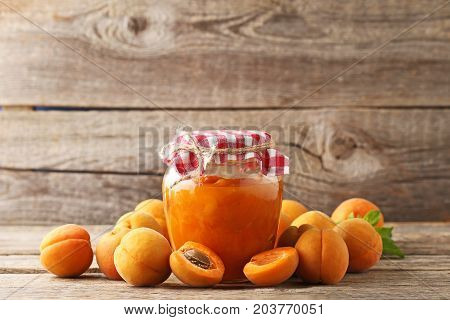 Apricot Jam In Glass Jar On Grey Wooden Table