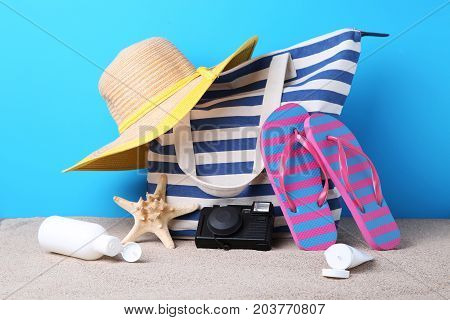 Summer Bag With Hat, Flip Flops, Camera And Starfish On Beach Sand