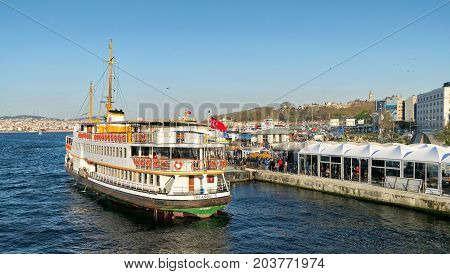 Istanbul Turkey - April 25 2017: Passengers Loading into local ferry in Eminonu ferry terminal before sunset Istanbul Turkey