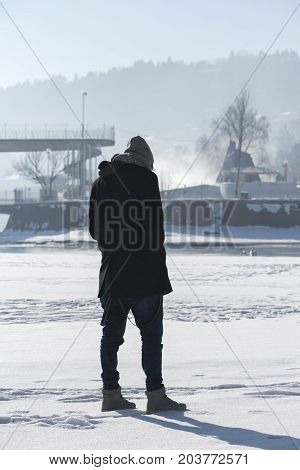 Young Man Frozen Lake Snow Sunny Day