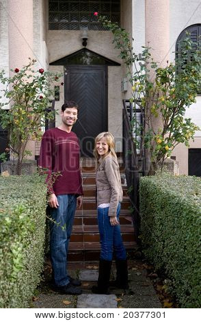 couple in front of a new house