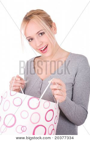 girl holding shopping bag and smiling