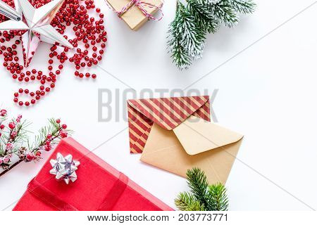 prepare new year and christmas 2018 presents in boxes and envelopes on white desk background top veiw mockup