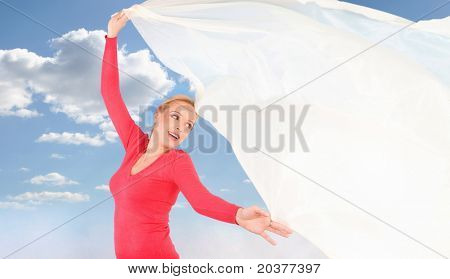woman holding a cloth against cloudy sky