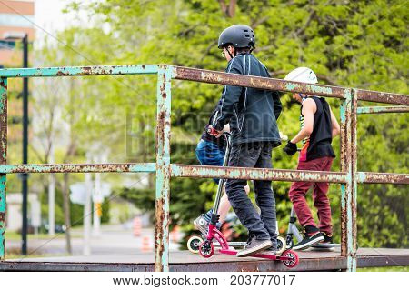 Saguenay, Canada - June 3, 2017: Downtown City Summer Park In Quebec With Backs Of Young Teenagers B