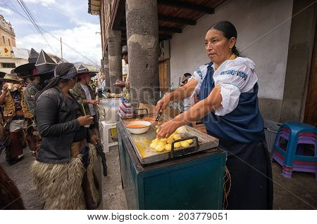June 25 2017 Cotacachi Ecuador: food stands at the side of the main plaza are offering refreshments for the tired dancers