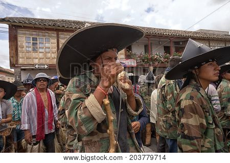 June 25 2017 Cotacachi Ecuador: indigenous kichwa man using the seashell horn at the Inti Raymi parade