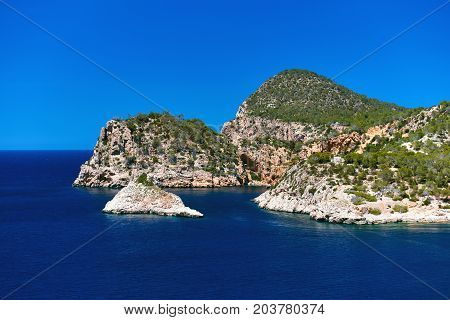 Coastline surrounded by stone formations in Ibiza. Balearic Islands. Spain