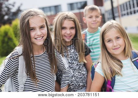 The Great Portrait Of School Pupils Outside Classroom Carrying Bags