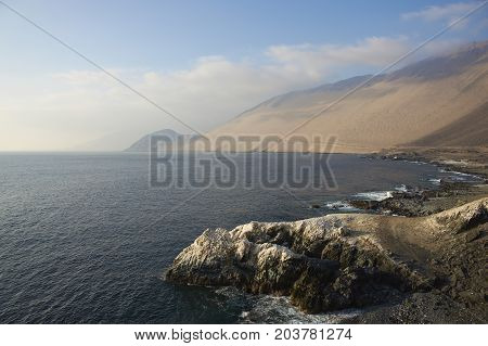 White guano covered cliffs along the Pacific coast of northern Chile.