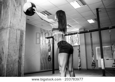 Woman training with functional gymnastic in the crossfit gym