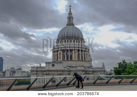 London UK - August 3 2017: St. Paul's Cathedral view from the top of 1 New Change. Shows a couple looking over the railing in the foreground.