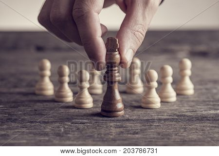 Human Hand Putting King Chess Piece