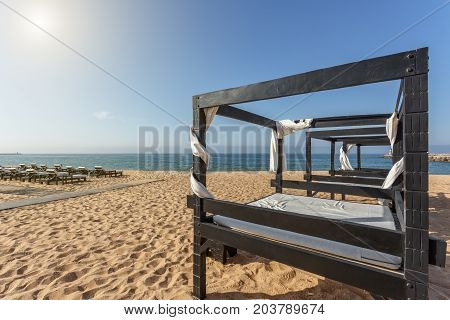 Loungers for tourists close-up on the beach in the Algarve. Portugal