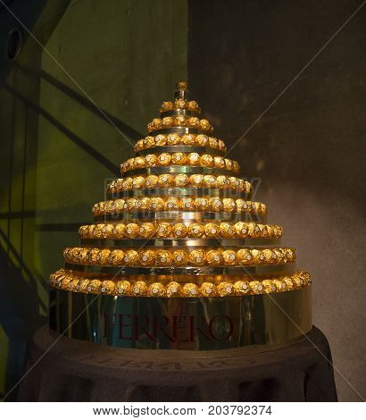 Tokyo, Japan - July 26, 2017: Close up of a beautiful tower of golden ferrero rocher chocolate, in a convention in the city of Tokyo, by Ferrero Rocher campaigns in Tokyo, Japan.