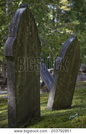 Old and weathered tombstones in New England, U.S.A.