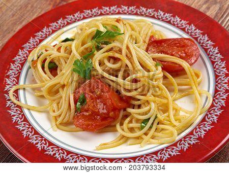 Spaghetti Piccanti al Pomodoro Fresco   close up meal  cooking