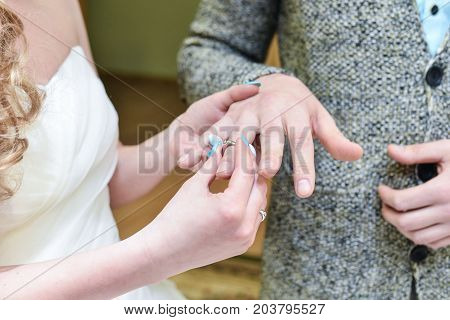 He Put the Wedding Ring on Her wedding rings hands