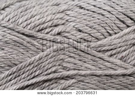 A super close up image of silver yarn