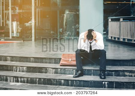 Unemployed Tired Or Stressed Businessman Sitting On The Walkway After Work Stressed Businessman Conc
