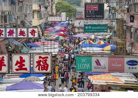 Hong Kong, China - Jun 2, 2017: People shopping at the Fa Yuen Street Market in Hong Kong. It is full of shops and stalls selling bargain-priced clothing and accessories.