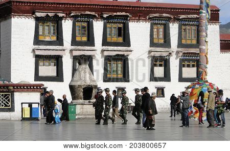 Chinese Soldiers Walking At The Jokhang Temple