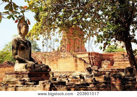 Travel To Ayutthaya, Thailand. The Ruins Of Ancient City With Statue Of Buddha. Ayutthaya Historical