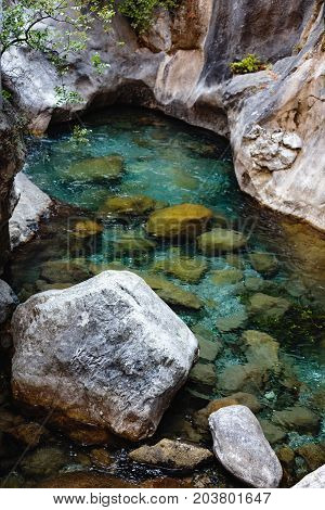 Vertical shot of crystal clear water in mountain river in Sapadere canyon near Alanya of Turkey