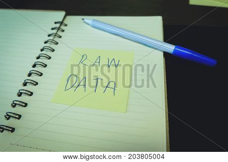 Raw data Post it in the notebook paper with ink pen education. Office supplies