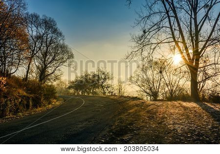 Countryside Road In Late Autumn Fog At Sunrise