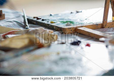 colorful oil paints on wooden palette. workspace artist