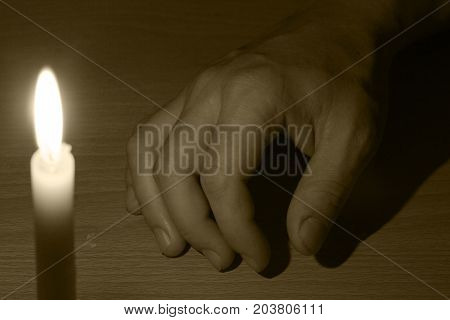 dead hand and the light from the candles
