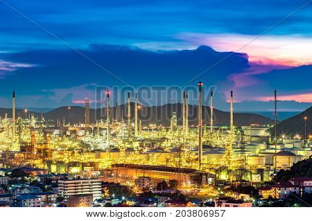 The refinery is located in one of the city during the sunset behind the hills to the sea a beautiful pictures can be made into a background image of engineering. Thai Oil Thaioil.