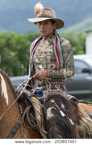 June 3 2017 Machachi Ecuador: Andean cowboy on horseback wearing chaps