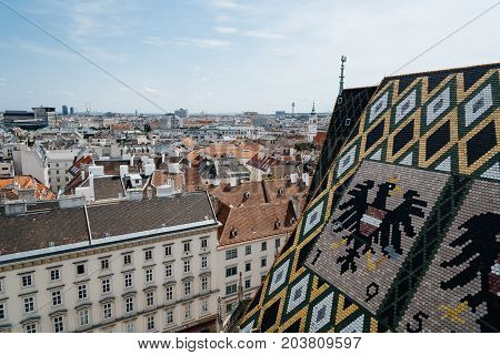 Vienna, Austria - August 16, 2017: Panoramic view of Vienna from the roof of Cathedral of St Stephen. Built in romanesque and gothic style, with its multi-coloured tile roof is one of the city's most recognizable symbols
